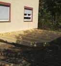 Montage der Balkenlage für den Boden